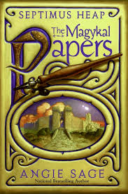 A golden book cover with a city set in an oval on the front cover. Title Magical Papers.