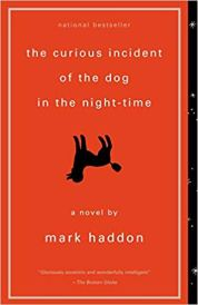 A red cover with the title features the silhouette of an upside down dog.