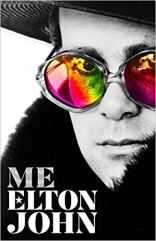 "cover of Elton John book """"Me"" featuring Elton wearing rainbow sunglasses"